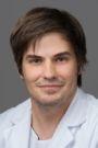 Dr. Dominik Baschera